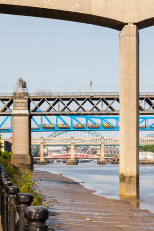 The view beneath Redheugh Bridge along the River Tyne in Northern England.  The numerous bridges connect Newcastle upon Tyne and Gateshead.