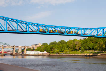 The Queen Elizabeth II bridge over the River Tyne in North East England.  A Tyne and Wear Metro train is seen crossing between Newcastle upon Tyne and Gateshead.