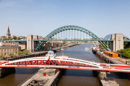 The view from the High Level Bridge over the River Tyne to the Swing and Tyne Bridges.  The bridges connect Newcastle upon Tyne and Gateshead.