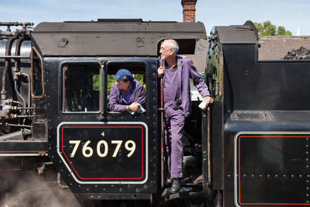 A close up of the driver and fireman on steam train 76079.  The train prepares to depart Grosmont Station, on the North Yorkshire Moors Railway. 報道画像