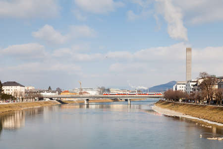 The view along the Salzach River in Salzburg, Austria as a passenger train crosses the railway bridge. 報道画像