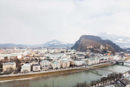 A winter view across the Salzach River in Salzburg, Austria.  In the background can be seen Kapuzinerberg, a hill on the eastern banks of the Salzach River.