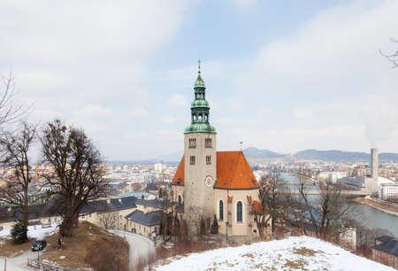 A winter view of the parish church Mulln, a Roman Catholic church in Salzburg, Austria.