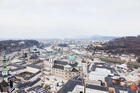 The view across Salzburg Old Town in Austria.  In the foreground is Salzburg Cathedral, a Roman Catholic cathedral built in a Baroque style.