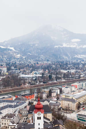 The view across Salzburg Old Town and the Salzach River in Austria.  In the background can be seen Gaisberg a mountain to the East of the city.