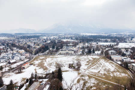 The winter view from the summit of Festungsberg across the southern Salzburg skyline in Austria.