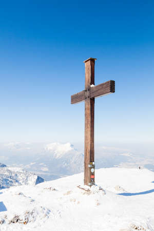 A cross marks the summit of Untersberg mountain in Austria.  The mountain straddles the border between Germany and Austria.