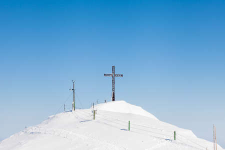 The view across the summit of Untersberg mountain in Austria looking towards a cross.  The mountain straddles the border between Germany and Austria. 写真素材