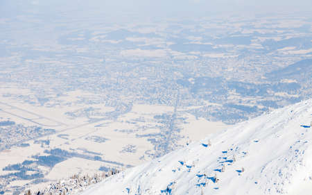 The view from the summit of Untersberg mountain in Austria.  The mountain straddles the border between Germany and Austria and in the background can be seen the city of Salzburg. 写真素材