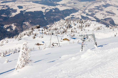 Looking from the summit of Untersberg mountain in Austria towards a ski lift.  The mountain straddles the border between Germany and Austria. 写真素材