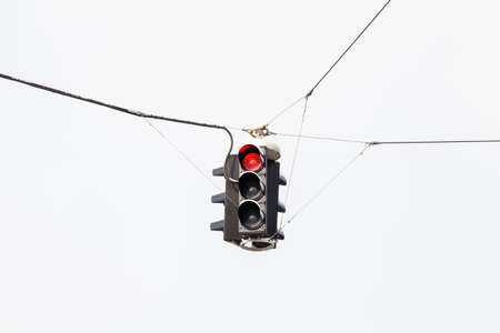 A snow covered suspended red traffic light is pictured in mid winter in Salzburg, Austria. 写真素材