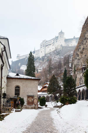 A mid winter view from Salzberg Old Town, Austria looking towards Hohensalzburg Fortress.  The fortress sits atop the Festungsberg a small hill.