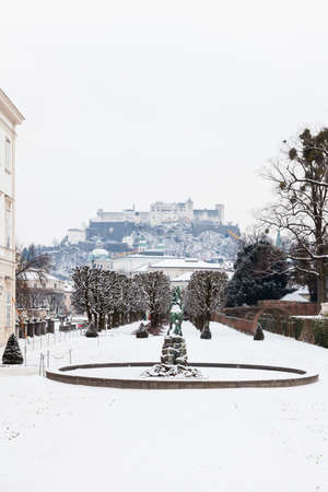 A mid winter view across Mirabell Gardens in Salzburg, Austria.  In the background can be seen Hohensalzburg Fortress sitting atop Festungsberg, a small hill. 報道画像