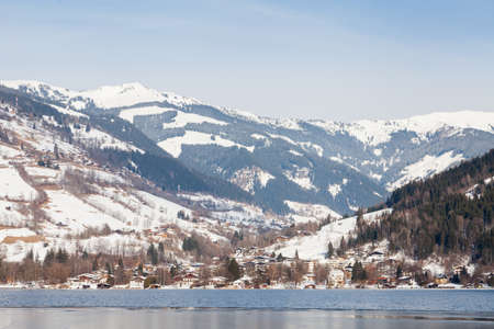 The view from the Austrian town of Zell am See across Lake Zell towards a winter landscape.