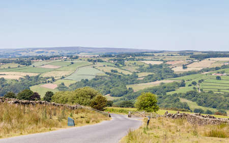 The view along a country lane in the North York Moors National Park, England.
