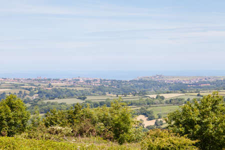 The view across the North York Moors National Park, England towards the seaside town of Whitby. 写真素材