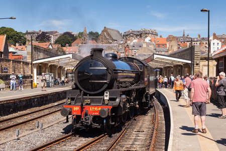 A steam train is pictured in Whitby Station on the North Yorkshire Moors Railway.