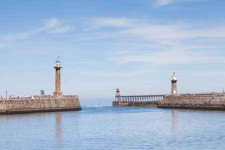 The east and west piers at the entrance to the seaside town of Whitby in Yorkshire, Northern England.