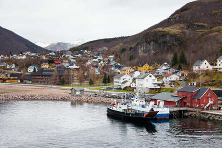 Boats moored on the Ornes quayside in Norway.  Ornes is a village in the county of Nordland, Northern Norway.