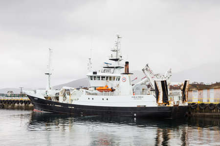 Fishing vessel, Straumbas, is pictured moored in Alesund, Norway.  Alesund is a port town on the west coast of Norway.