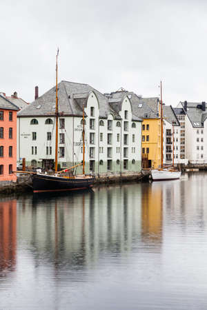 Historic buildings line the Alesund waterfront in Norway.  Alesund is a port town on the west coast of Norway.