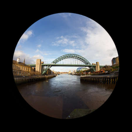 A fish eye view of the Tyne Bridge in Newcastle upon Tyne, England.  The Sage, a centre for musical education and performance, is in the background.