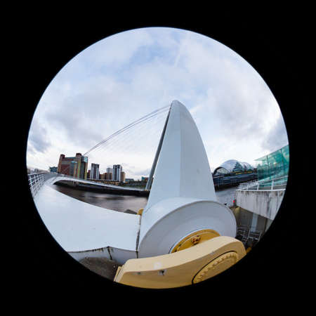 A close up fish eye view of the Gateshead Millennium Bridge in North East England.  The bridge connects Newcastle upon Tyne and Gateshead.