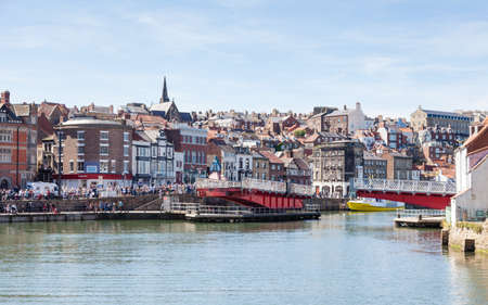 The view across the River Esk towards the Swing Bridge in the seaside town of Whitby, Yorkshire in Northern England.