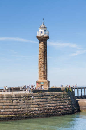 A close up view of Whitby Harbour West lighthouse from the seaside town of Whitby, Yorkshire in Northern England.