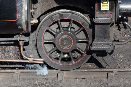A close up of the leading wheel on a steam train. Redactioneel