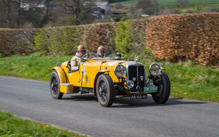A 1936 Alvis Speed 25 climbs Southwaite Hill in Cumbria.  The car is taking part in the 11th Flying Scotsman Rally, a free public-event.