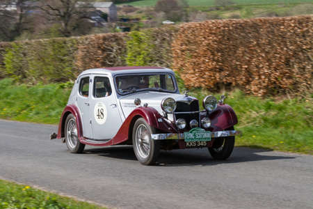 A 1934 Riley Kestrel climbs Southwaite Hill in Cumbria, northern England.  The car is taking part in the 11th Flying Scotsman Rally, a free public-event.