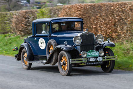 A 1931 Hupmobile S Coupe climbs Southwaite Hill in Cumbria, northern England.  The car is taking part in the 11th Flying Scotsman Rally, a free public-event.