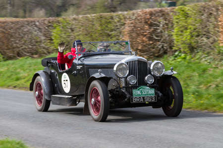 A 1935 Bentley Derby Sports Tourer climbs Southwaite Hill in Cumbria, northern England.  The car is taking part in the 11th Flying Scotsman Rally, a free public-event.