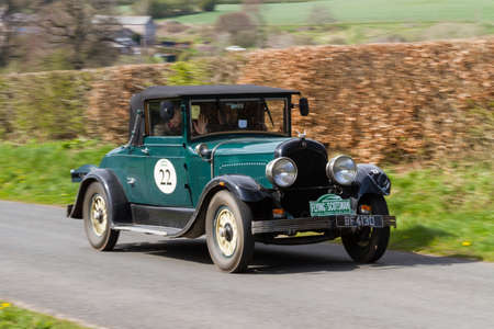 A 1928 Chrysler 72 climbs Southwaite Hill in Cumbria on April 5, 2019.  The car is taking part in the 11th Flying Scotsman Rally, a free public-event.