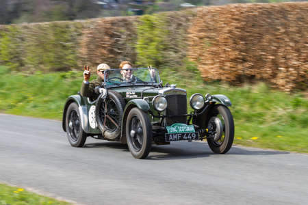 A 1933 Frazer Nash TT Replica climbs Southwaite Hill in Cumbria, northern England.  The car is taking part in the 11th Flying Scotsman Rally, a free public-event.