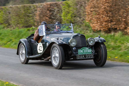 An Aston Martin 2 Litre Sport climbs Southwaite Hill in Cumbria, England.  The car is taking part in the 11th Flying Scotsman Rally, a free public-event.