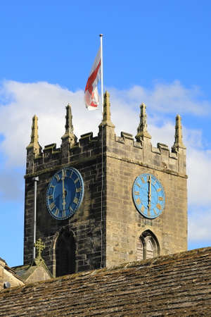 The clock tower of St Michael and All Angels' Church in Haworth, West Yorkshire.  Patrick Bronte, father of the Bronte sisters, served as a minister of the parish in the 19th century.