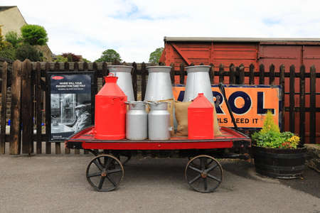 A fully laden luggage trolley is pictured on Oakworth Station on the Keighley and Worth Valley Railway in England.  The station was used in the film the Railway Children.