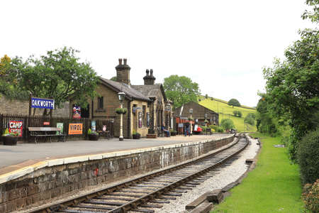 The view along the platform of Oakworth Station on the Keighley and Worth Valley Railway in northern England.  The station was used in the film the Railway Children.