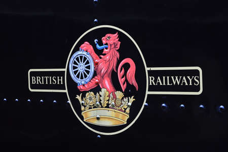 A British Railways logo on a steam train tender on the Keighley and Worth Valley Railway, England.  The corporate logo was used between 1956 and 1965.