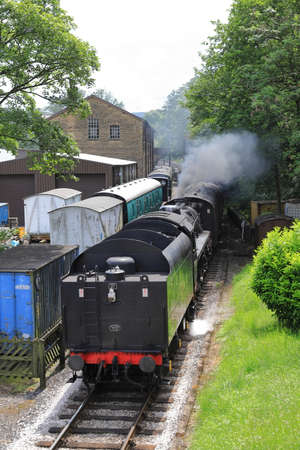 A steam train arrives in Haworth Station, on the Keighley and Worth Valley Railway, England.  The railway was used in the film the Railway Children. Redactioneel