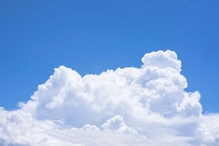 fluffy clouds: fluffy white clouds and clear blue sky