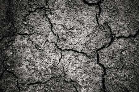 vignetting: Dark dramatic of cracked soil with vignetting, sad feeling