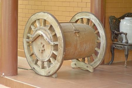 Old wood beer barrel stands on cart wheels photo