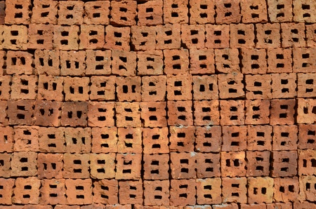 Holes in red bricks texture photo