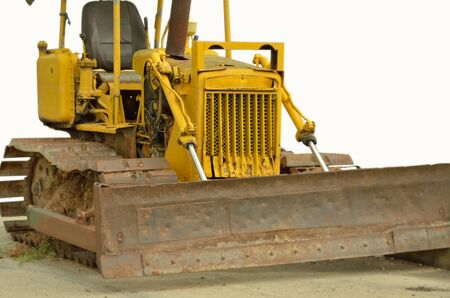 Old yellow caterpillar tractor Stock Photo - 21379567