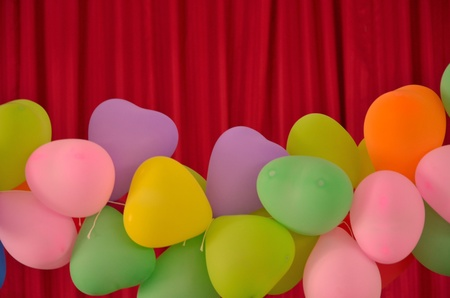 Beautiful color balloons on red blinds photo