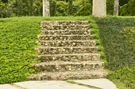 Stone and concrete stairs on the hill photo
