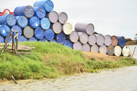 Color barrels beside the river photo